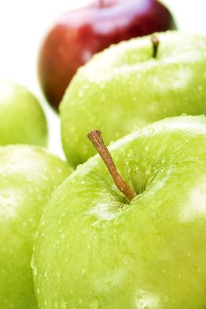 Stock image of Green and Red Apples, selective focus on front apple