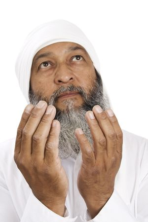 Stock image of Arab man praying over white background, selective focus on hands