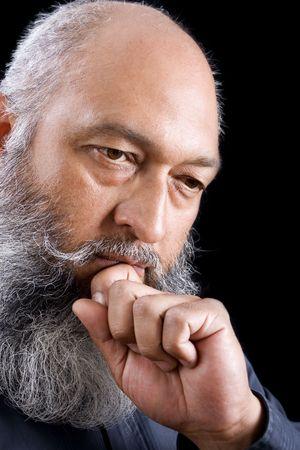 Stock image of bearded man over dark background