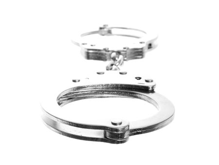 Stock image of handcuffs perspective, focus on front cuff. Isolated on white. Stock Photo - 6296849