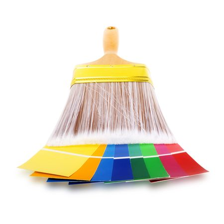 Stock image of paintbrush and color swatches over white background. For Home remodeling or improvement concepts. photo