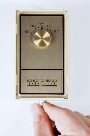Stock image de main r�gler le thermostat