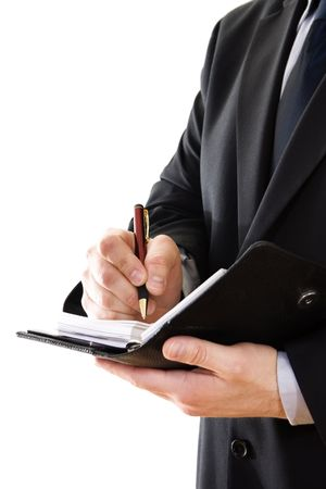 person writing: Stock image of businessman writing on a planner, isolated on white.