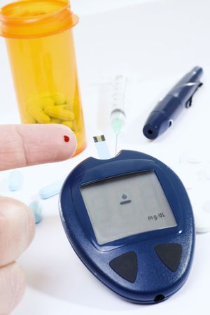 diabetes needles: Stock image of person testing blood sugar levels Stock Photo