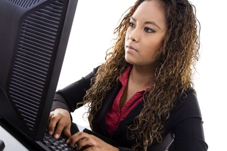 Stock image of young businesswoman typing on computer over white background photo