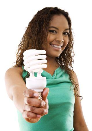 ahorro energetico: Stock imagen de chica sosteniendo una ahorro bombillas fluorescentes compactas sobre fondo blanco, concentraci�n selectiva por parte de la energ�a y la bombilla.