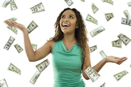gevangen: Stock beeld van de vrouw permanent met open armen temidden van dalende geld Stockfoto