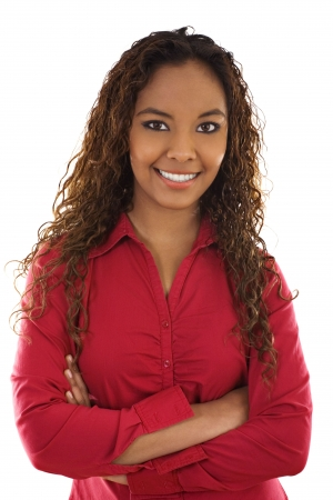 Stock image of woman standing with her arms crossed, over white background