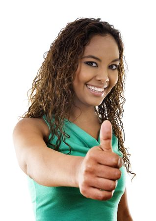 Stock image of woman standing with thumbs up, over white background