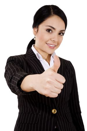 Businesswoman standing gesturing thumbs up, over white background. Stock Photo - 6671114