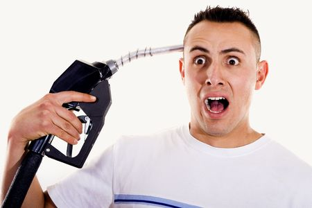 Stock image of man shouting and pointing a fuel pump nozzle at his head