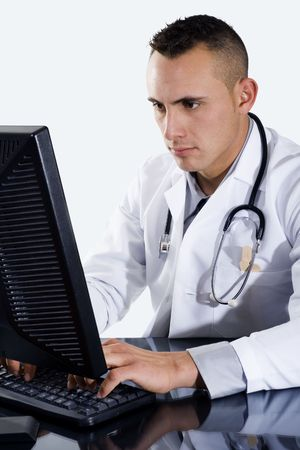 Stock image of doctor typing on computer  photo