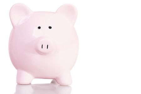 Stock image of pink piggy bank with copy space over white background photo