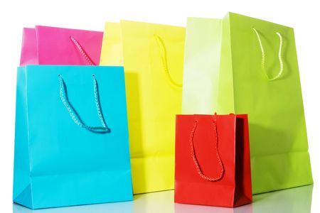 Stock image of multi colored bags over white background Archivio Fotografico