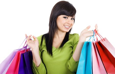 Stock image of happy female shopper, over white background. photo