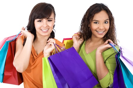 Stock image of two women carrying shopping bags photo