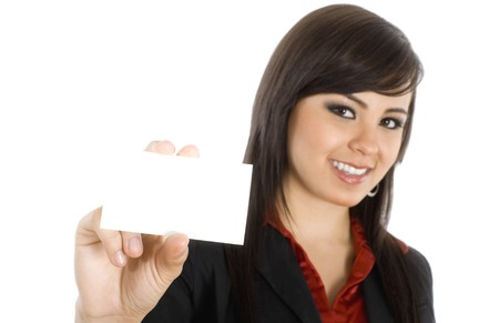 Stock image of businesswoman showing business card, selective focus on hand ( foreground ). Over white background. 免版税图像