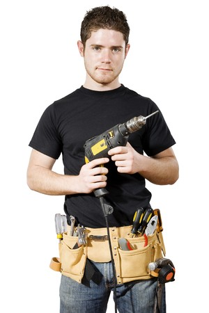 Stock image of male handymanworker over white background photo