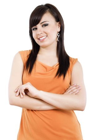 Stock image of young woman standing with arms crossed over white background Stock Photo - 6944923