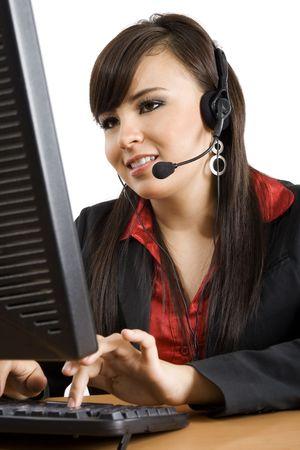 Stock image of female call center operator over white background photo