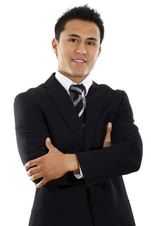 Stock image of hispanic businessman standing with arms crossed over white background