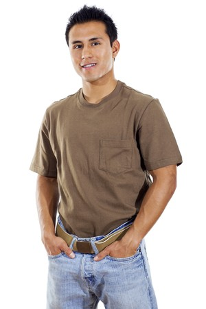 Stock image of hispanic man standing with hands in pockets over white background