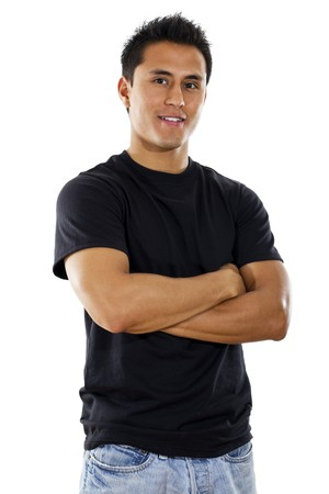 crossed arms: Stock image of hispanic young adult standing with arms crossed over white background Stock Photo