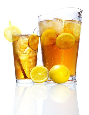 Stock image of pitcher and glass of Iced tea garnished with lemons over white background with reflection on bottom, could be Long Island Iced Tea. Find more cocktail and prepared drinks images on my portfolio.  photo