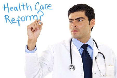 health care concept: Stock image of doctor writing Health Care Reform? over white background