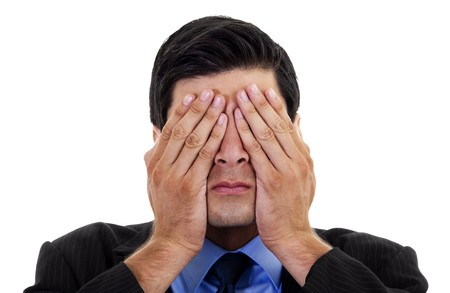hidden: Stock image of businessman covering his eyes with his hands, over white background Stock Photo