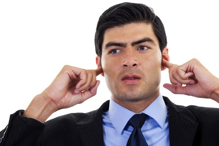 covering: Stock image of businessman covering his ears with his hands, over white background Stock Photo