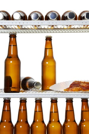 dorm: Stock image of interior of a refrigerator full of beers and a slice of pizza
