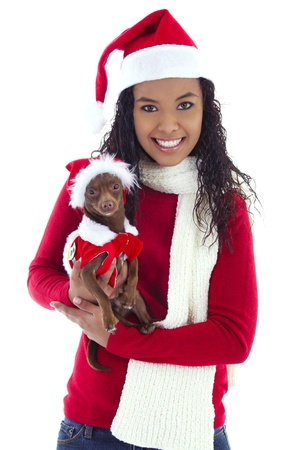 Stock image of woman holding pet Chihuahua, both wearing christmas costume photo