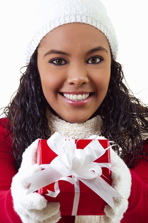 Stock image of female holding gift. Wearing winter clothing. photo
