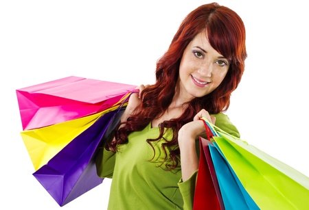 Stock image of cheerful woman holding shopping bags over white background photo