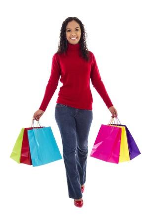 compras compulsivas: Imagen stock de comprador femenina con coloridos bolsas de la compra