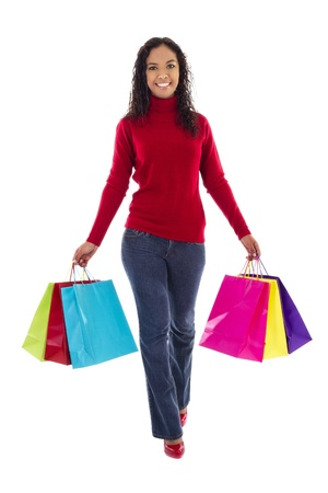 Stock image of female shopper with colorful shopping bags