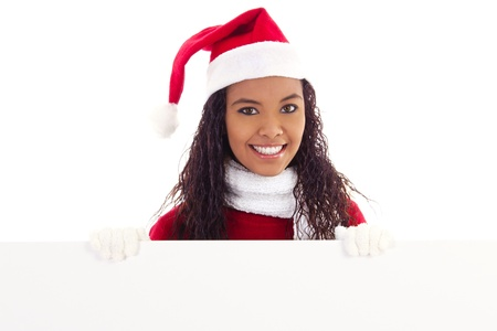 Stock image of woman wearing santa hat holding blank board with copy space photo