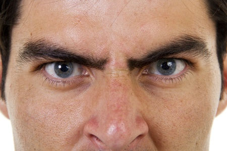 Stock image of closeup of angry male face photo