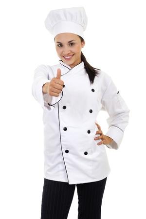 親指をあきらめて、白で隔離される女性シェフのストック画像