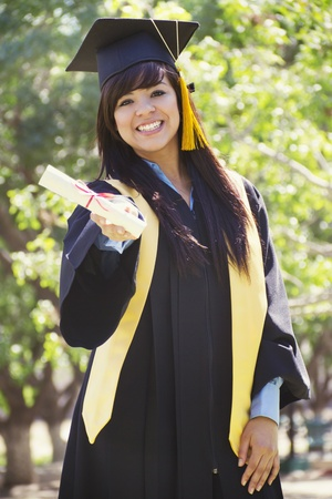 Stock image of happy female graduate, outdoor setting photo