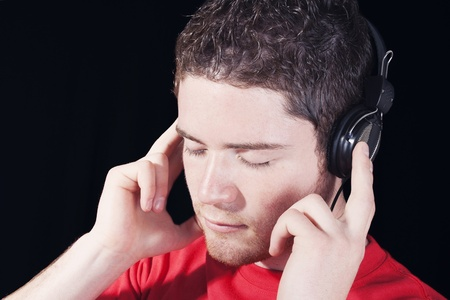 closeup of a male disk jockey dj with headphones over dark background photo
