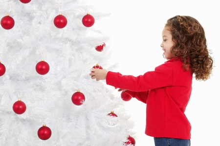 Stock image of cute little girl decorating a christmas tree  photo