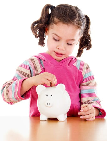Stock image of little girl learning the value of saving