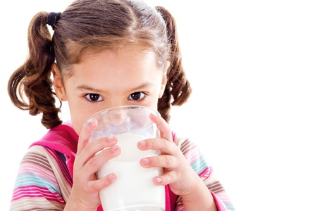 glass of milk: Stock image of female child drinking glass of milk