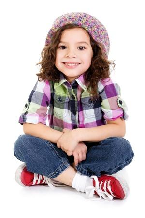 행복 여성 취학 연령의 아이가 흰색 배경 위에 앉아의 재고 이미지 스톡 콘텐츠
