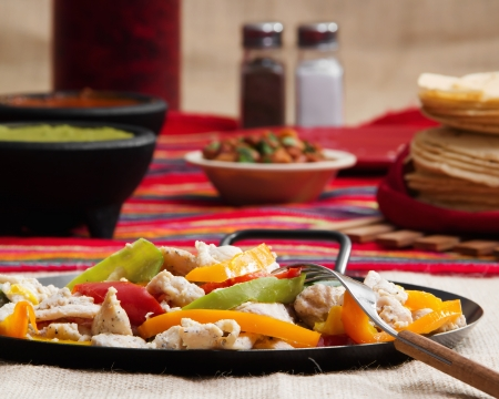 Stock image of chicken fajita plate on restaurant table