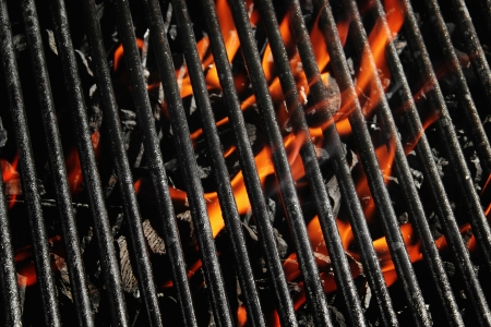 Stock image of charcoal fire grill, close up with live flames photo