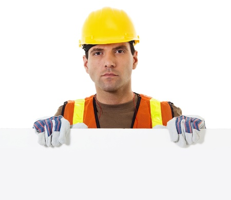 Stock image of construction worker holding blank sign with copy space 스톡 콘텐츠