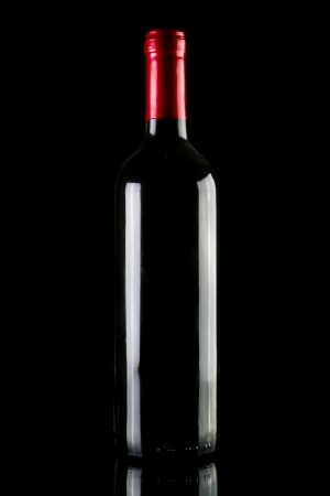 Stock image of wine bottle over dark Stock fotó